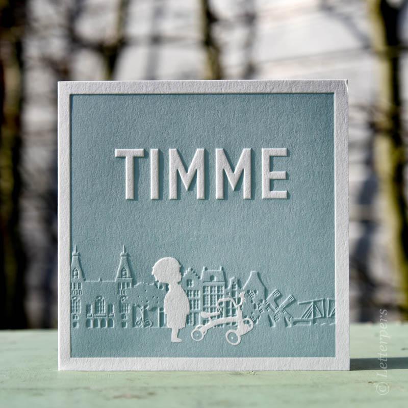 Letterpers met skyline Amsterdam