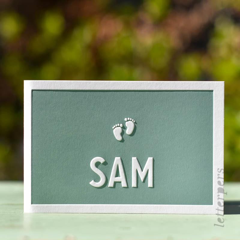 voetjes op het geboortekaartje, groen letterpress