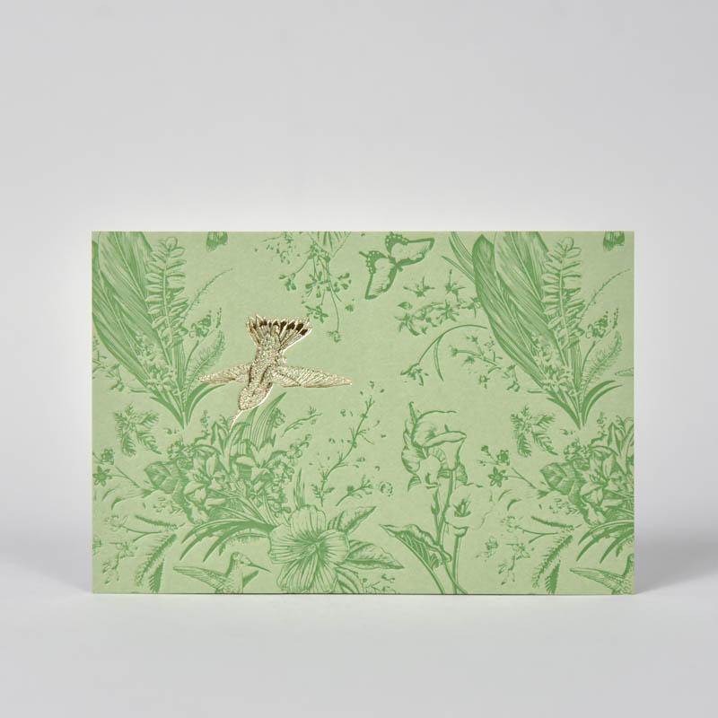 Kaart met bloemen en een vogel in goudfolie